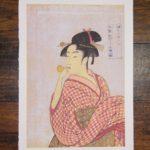 Young Woman Blowing a Glass Pipe (poppin) by Kitagawa Utamaro